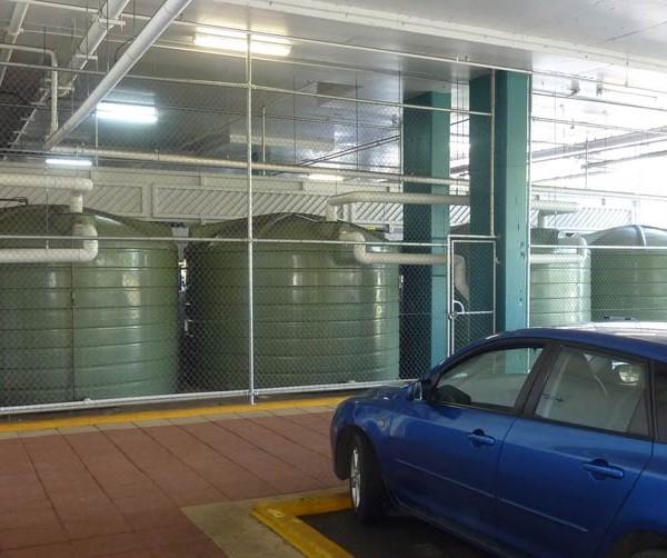 bank of 5000 gallon rainwater tanks