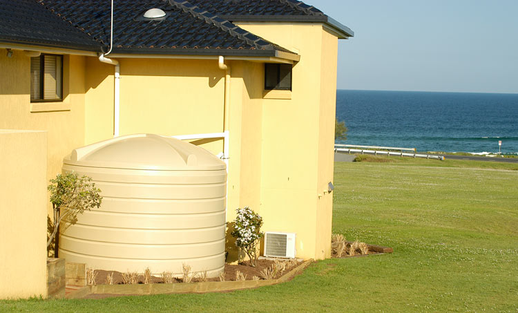 cream white water tank near beach 13500 litres