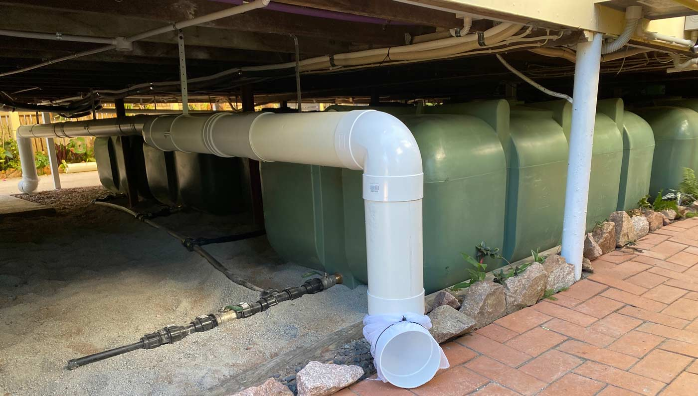 Duraplas UD 2000 Litre Underdeck Water Tank with Multiple Tanks Plumbed Together Under a Building
