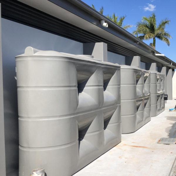5,000 Litre Slimline Tanks Installed Along the Side of a Building